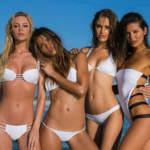 Vier mooie strandbabes in bikini